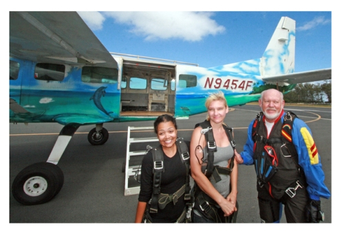 Jane (l) boarding for her second skydive with friends Patricia and Larry.