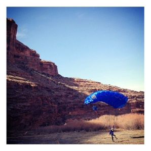 Eula landing at G Spot on Colorado River after a BASE jump from the cliffs above.