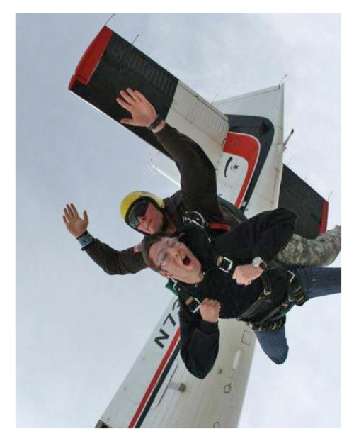 Chase, here as a tandemmaster, takes others on their first skydive